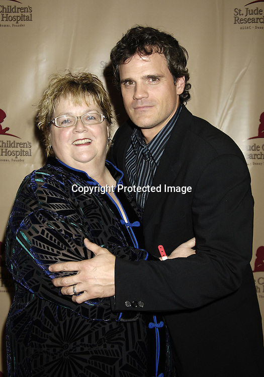 Carol Robinson and Michael Park . She bid to be in Soap Opera Digest ..at the 11th Annual Daytime Television Salutes St. Jude Children's Research Hospital benefit hosted by Martha Byrne on October 14, 2005 at The New York Marriott Marquis Hotel. ..Photo by Robin Platzer, Twin Images