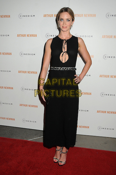 "Emily Blunt.""Arthur Newman"" Los Angeles Premiere held at Arclight Cinemas, Hollywood, California, USA, 18th April 2013..full length black dress sleeveless hand on hip clutch bag cut out tied beaded waistband embellished sandals open toe gold strappy .CAP/ADM/BP.©Byron Purvis/AdMedia/Capital Pictures"