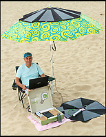 BNPS.co.uk (01202 558833)<br /> Pic: TomWren/BNPS<br /> <br /> Beachlovers will never have to worry about their mobile going dead on a day out again - thanks to a renewable energy expert's new invention.<br /> <br /> Entrepreneur Eric Hawkins, 69, has come up with the Solarbrella - a clever fold-away solar panel that fits over a beach parasol and allows people to charge their phone or plug in a speaker to listen to music while they catch some rays.<br /> <br /> The clever system provides enough energy to run a laptop for 11 hours and has four USB ports so people can power multiple devices at once.<br /> <br /> Mr Hawkins is now looking for an investor so he can get the first 100 produced and start selling them to the general public.