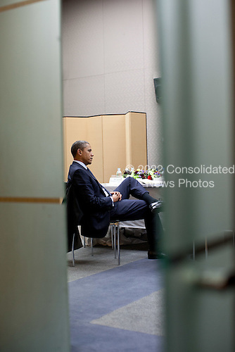 United States President Barack Obama talks with National Security Advisor Tom Donilon during a break in the Nuclear Security Summit at the Coex Center in Seoul, Republic of Korea, March 27, 2012. .Mandatory Credit: Pete Souza - White House via CNP