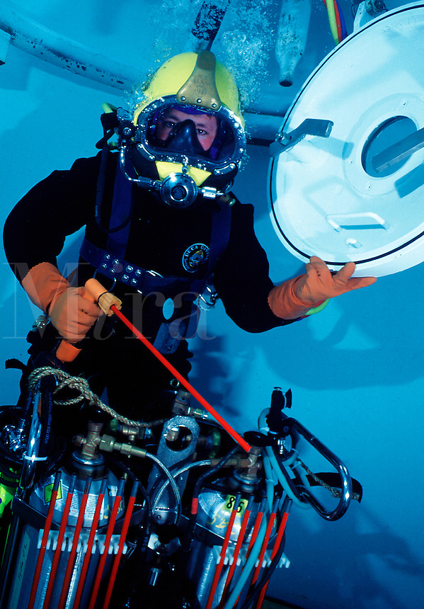 Commercial diver (deep sea diver) with underwater arc-oxygen cutting system.Santa Barbara, CA.