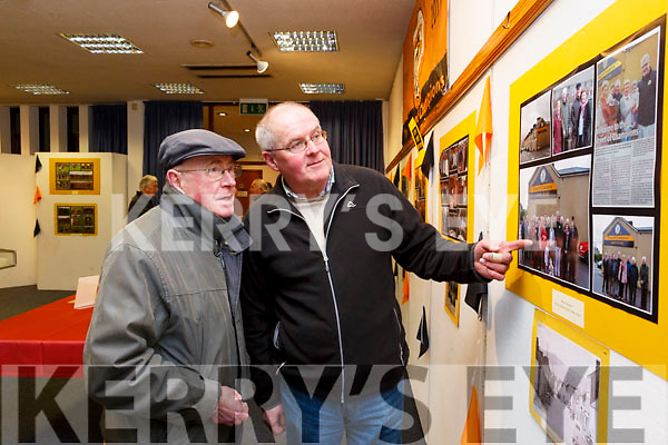 Martin Collins and Paudie Commane enjoying the photos on display at the Austin Stacks GAA clubs photographic exhibition launch in the Kerry County Library on Tuesday night last, highlighting events organised by the club for their centenary year.