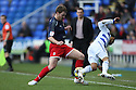 Scott Laird of Stevenage tackles Jobi McAnuff of Reading.Reading v Stevenage - FA Cup 3rd Round - Madejski Stadium,.Reading - 7th January, 2012.© Kevin Coleman 2012