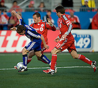 26 April 2009:  Kansas City Wizards midfielder Lance Watson #6 runs with the ball as Toronto FC forward Chad Barrett #19 and Toronto FC midfielder Jim Brennan #11 give chase during an MLS game at BMO Field between Kansas City Wizards and Toronto FC.Toronto FC won 1-0. .