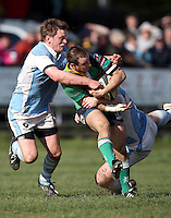 Ballynahinch out half Ryan Bambry on the attack is tackled by Mike Sherry and Frank McKenna during the AIB Cup semi-final against Garryowen at Ballymacarn Park, Ballynahinch. Mandatory Credit - John Dickson