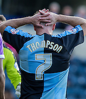 Garry Thompson of Wycombe Wanderers after a missed opportunity during the Sky Bet League 2 match between Wycombe Wanderers and Plymouth Argyle at Adams Park, High Wycombe, England on 12 September 2015. Photo by Andy Rowland.