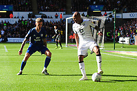 Joe Bennett of Cardiff City vies for possession with Andre Ayew of Swansea City during the Sky Bet Championship match between Swansea City and Cardiff City at the Liberty Stadium in Swansea, Wales, UK. Sunday 27 October 2019