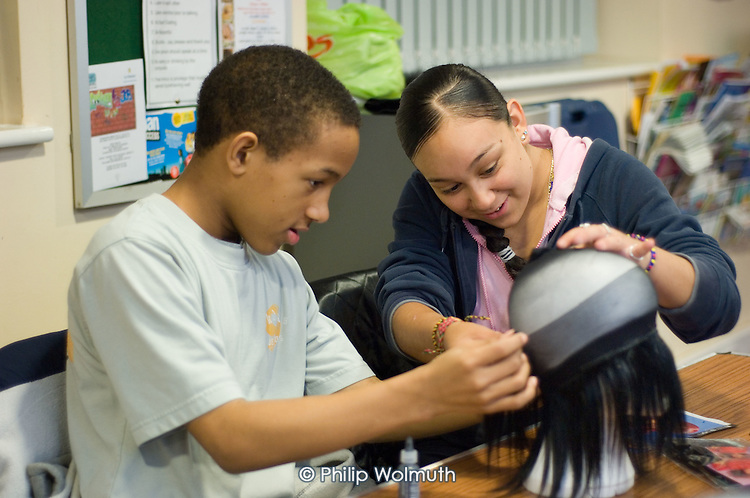 Hairdressing class at Fisherton Estate youth club
