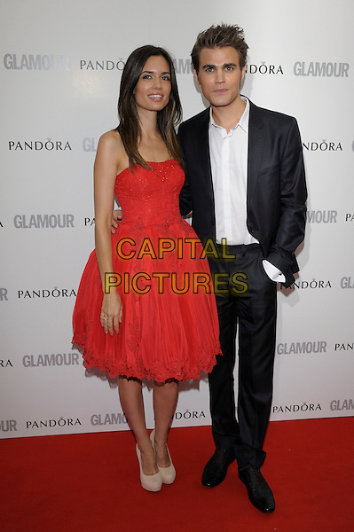 Torrey Devitto and Paul Wesley.Women Of The Year 2012 - Glamour Awards, Berkeley Square, London, England..29th May 2012.full length black white suit shirt red strapless dress couple .CAP/PL.©Phil Loftus/Capital Pictures.