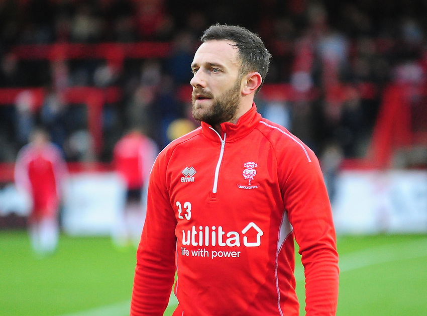 Lincoln City's Neal Eardley during the pre-match warm-up<br /> <br /> Photographer Andrew Vaughan/CameraSport<br /> <br /> The EFL Sky Bet League Two - Stevenage v Lincoln City - Saturday 8th December 2018 - The Lamex Stadium - Stevenage<br /> <br /> World Copyright © 2018 CameraSport. All rights reserved. 43 Linden Ave. Countesthorpe. Leicester. England. LE8 5PG - Tel: +44 (0) 116 277 4147 - admin@camerasport.com - www.camerasport.com