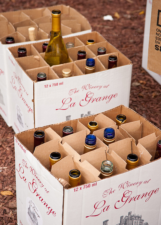 At the end of the day, staff bring the boxes of empty bottles out the back door for disposal -- remains of the day's sales at the Winery at La Grange.