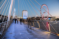 The London Eye, seen from Golden Jubilee Bridge at night, London, England