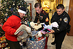 Workers help Marine Sgt. Justin Block and Capitol Police officer Mike Rubio  gather up donated toys from the 8th annual Toys for Tots toy drive coordinated by the Capitol Police at the Capitol in Carson City, Nev. on Friday, Dec. 17, 2010. More than a dozen state agencies participated in the event which helps more than 7,000 kids in Carson, Douglas, Lyon and Storey counties..Photo by Cathleen Allison