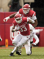 Hawgs Illustrated/BEN GOFF <br /> David Williams, Arkansas running back, evades Montez Sweat, Mississippi State linebacker, as Brian Wallace, Arkansas offensive lineman, blocks in the fourth quarter Saturday, Nov. 18, 2017, at Reynolds Razorback Stadium in Fayetteville.