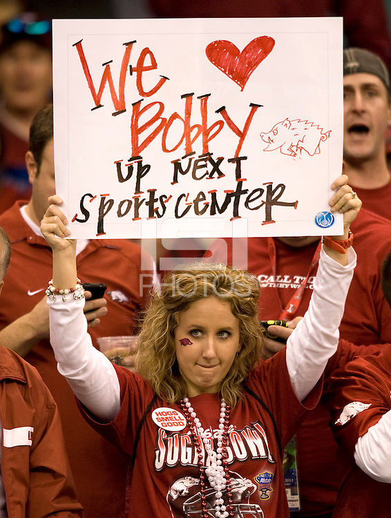 "Arkansas fan holds up a sign says ""We love Bobby up next sportscenter"" during 77th Annual Allstate Sugar Bowl Classic at Louisiana Superdome in New Orleans, Louisiana on January 4th, 2011.  Ohio State defeated Arkansas, 31-26."