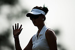 CHON BURI, THAILAND - FEBRUARY 16:  Michelle Wie of USA waves to the crowd after a putt on the 17th green during day one of the LPGA Thailand at Siam Country Club on February 16, 2012 in Chon Buri, Thailand.  Photo by Victor Fraile / The Power of Sport Images