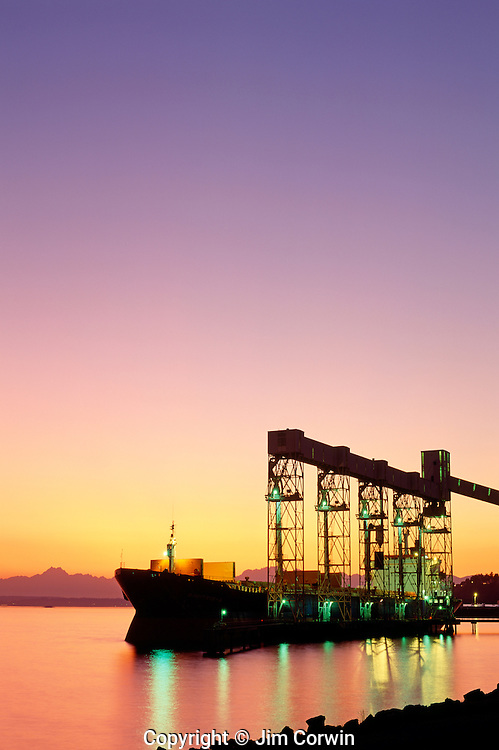 Sunset over Elliot Bay with a tanker moored at the Grain Terminal at the Port of Seattle