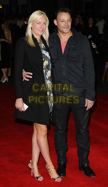 Stella English &amp; Toby Anstis<br /> attended the &quot;One Chance&quot; UK film premiere, Odeon Leicester Square cinema, Leicester Square, London, England, UK, 17th October 2013.<br /> full length black coat green floral print dress arm around <br /> CAP/CAN<br /> &copy;Can Nguyen/Capital Pictures