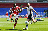 Bolton Wanderers' Aaron Wilbraham crosses under pressure from Nottingham Forest's Tendayi Darikwa<br /> <br /> Photographer Andrew Kearns/CameraSport<br /> <br /> The EFL Sky Bet Championship - Bolton Wanderers v Nottingham Forest - Sunday 6th May 2018 - Macron Stadium - Bolton<br /> <br /> World Copyright &copy; 2018 CameraSport. All rights reserved. 43 Linden Ave. Countesthorpe. Leicester. England. LE8 5PG - Tel: +44 (0) 116 277 4147 - admin@camerasport.com - www.camerasport.com