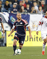 New England Revolution substitute midfielder Chad Barrett (9) looks to pass. In a Major League Soccer (MLS) match, the New England Revolution (blue) defeated D.C. United (white), 2-1, at Gillette Stadium on September 21, 2013.