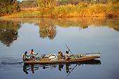 Mbati, Zambia, Africa. Losi tribespeople with laden canoe going to market.
