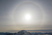 Sun Halo around Mount Lincoln from Mount Lafayette during the winter months in the White Mountains, New Hampshire USA. Halos are produced by the ice crystals in cirrus clouds.