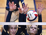 Althoff players Karinna Gall (left) and Grace Strieker leap to block a Minooka shot. Althoff lost to Minooka in the championship game of the O'Fallon Class 4A volleyball sectional at O'Fallon HS in O'Fallon, IL on November 6, 2019.<br /> Tim Vizer/Special to STLhighschoolsports.com