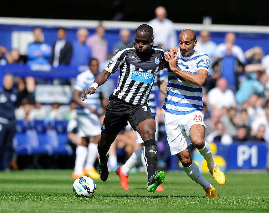 Newcastle United's Moussa Sissoko holds off the challenge from Queens Park Rangers' Karl Henry<br /> <br /> Photographer Ashley Western/CameraSport<br /> <br /> Football - Barclays Premiership - Queens Park Rangers v Newcastle United - Saturday 16th May 2015 - Loftus Road - London<br /> <br /> &copy; CameraSport - 43 Linden Ave. Countesthorpe. Leicester. England. LE8 5PG - Tel: +44 (0) 116 277 4147 - admin@camerasport.com - www.camerasport.com