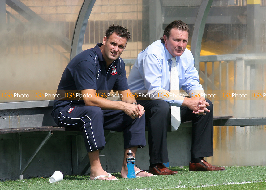 Lincoln City player, Stefan Oakes, sits alongside Lincoln Manager, Peter Jackson, in the away dug-out during Wycombe Wanderers vs Lincoln City, Coca Cola League Division Two Football at Adams Park on 23rd August 2008