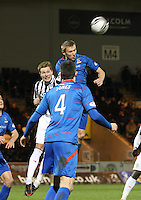 Richie Foran clears under pressure from Marc McAusland in the St Mirren v Inverness Caledonian Thistle Clydesdale Bank Scottish Premier League match played at St Mirren Park, Paisley on 30.1.13.