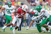 STANFORD, CA - SEPTEMBER 21: Connor Wedington #5 of the Stanford Cardinal runs with the ball as he is pursued by Nick Pickett #16 and Isaac Slade-Matautia #41 of the Oregon Ducks during a game between University of Oregon and Stanford Football at Stanford Stadium on September 21, 2019 in Stanford, California.