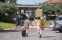 From left, Miki Konishi '18 gets a hand from his father, Yasuo Konishi, as he moves into Pauley Hall during Occidental College Orientation on Aug. 22, 2014. (Photo by Marc Campos, Occidental College Photographer)