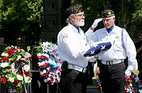 NWA Democrat-Gazette/DAVID GOTTSCHALK  Stuart Reeves salutes Samuel Grimes, both with American Legion Siloam Springs Post 29, Monday, May 29, 2017,  during the Folding of the Flag at the  Memorial Day 2017 Ceremony at Fayetteville National Cemetery.   The ceremony included traditional Color presentations, Rifle Volley, memorial wreath recognition and keynote speaker Governor Asa Hutchinson.