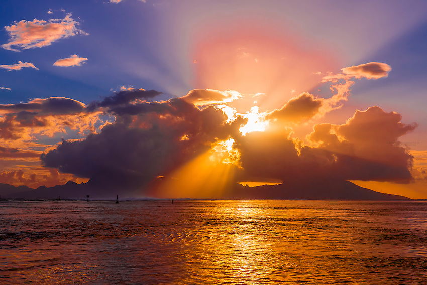 Sunset over the island of Moorea, seen from Tahiti, French Polynesia.