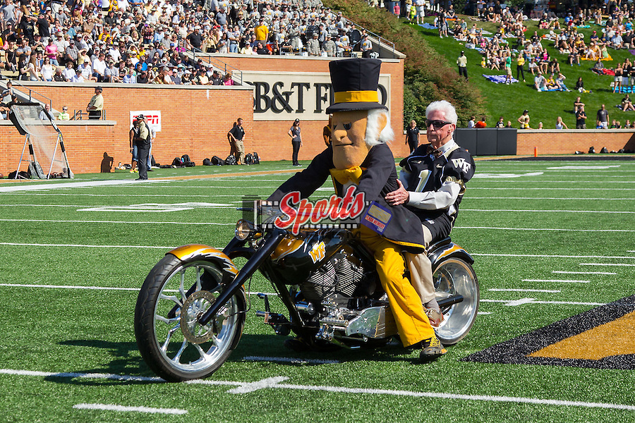 The Wake Forest Demon Deacons mascot rides his motorcycle on the field prior to the game against the Army Black Knights at BB&T Field on September 20, 2014 in Winston-Salem, North Carolina.  The Demon Deacons defeated the Black Knights 24-21.  (Brian Westerholt/Sports On Film)