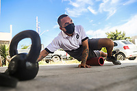 HERMOSILLO, MEXICO - MAY 08: Oscar Rai Villa de los Reyes footballer of the Cimarrones De Sonora performs several exercises of abdominal strength and gluteus in the garage of his house at a temperature of 40 degrees Celsius in the middle of the Coronavirus pandemic on May 8, 2020 in Hermosillo, Mexico. Due to the Coronavirus crisis the Liga MX has announced the cancellation of the Ascenso MX 2019-2020 season and to temporarily suspend promotions and relegations for the next six seasons. (Photo by Luis Gutierrez/Norte Photo/Getty Images)