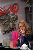 Lima, Peru. Elsa Maria Elejalde, a Limeno sophisticated woman, in a Silvestre restaurant drinking fruit juice.