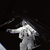 """In Earth Orbit - (FILE) -- Astronaut Russell Schweickart, lunar module pilot, stands on the module's deck during his spacewalk on the fourth day of the Apollo 9 mission, Friday, March 7, 1969. This photograph was taken from inside the lunar module """"Spider"""" by mission commander James McDivitt.  Apollo 9 was the first manned flight of the command/service module along with the lunar module. The mission's three-person crew, which also included command module pilot Dave Scott, tested several aspects critical to landing on the moon including the lunar module's engines, backpack life support systems, navigation systems and docking maneuvers. The mission was the second manned launch of a Saturn V rocket and was the third manned mission of the Apollo Program. After launching on March 3, 1969, the crew spent 10 days in low Earth orbit. .Credit: James McDivitt - NASA via CNP"""