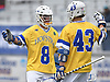 Jimmy Yanes #8 of Hofstra University, left, gets congratulated by teammate Ryan Tierney #43 after scoring a goal in the second quarter of an NCAA Division I men's lacrosse game against UMass at Shuart Stadium in Hempstead on Saturday, April 22, 2017. Hofstra won by a score of 15-8.