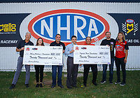 Sep 3, 2017; Clermont, IN, USA; NHRA top fuel driver Leah Pritchett and team owner Don Schumacher pose with charity donation checks during qualifying for the US Nationals at Lucas Oil Raceway. Mandatory Credit: Mark J. Rebilas-USA TODAY Sports