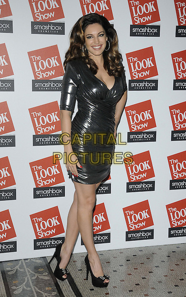 Kelly Brook.attended the Look Show in association with Smashbox cosmetics, Royal Courts of Justice, The Strand, London, England, 6th October 2012..full length silver shiny ruched lame dress hand on hip tight black peep toe shoes cleavage .CAP/CAN.©Can Nguyen/Capital Pictures.