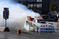 Jan 21, 2007; Las Vegas, NV, USA; NHRA Funny Car driver Ashley Force does a burnout during preseason testing at The Strip at Las Vegas Motor Speedway in Las Vegas, NV. Mandatory Credit: Mark J. Rebilas