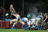 Chris Cook of Bath Rugby clears his line as James Hanks of Exeter Chiefs attempts to block his kick during the LV= Cup match between Exeter Chiefs and Bath Rugby at Sandy Park Stadium on Sunday 5th February 2012 (Photo by Rob Munro)