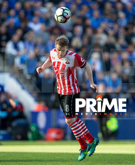 Steven Davis of Southampton wins the ball in the air during the Premier League match between Leicester City and Southampton at the King Power Stadium, Leicester, England on 2 October 2016. Photo by Andy Rowland.