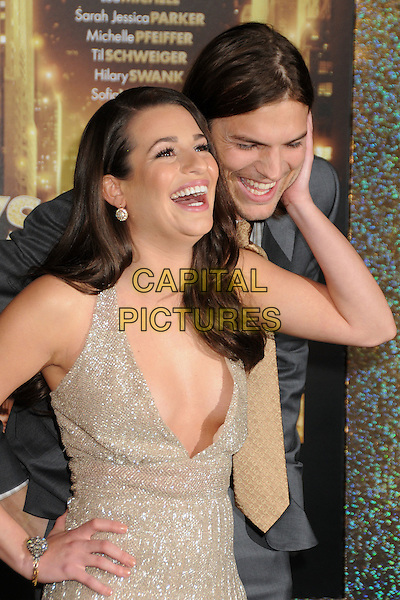 Lea Michele & Ashton Kutcher.'New Year's Eve' Los Angeles premiere at  Grauman's Chinese Theatre, Hollywood, California, USA..5th December 2011.half length gold beige dress low cut plunging neckline cleavage grey gray suit jacket smiling laughing hand on hip cheek.CAP/ADM/BP.©Byron Purvis/AdMedia/Capital Pictures.