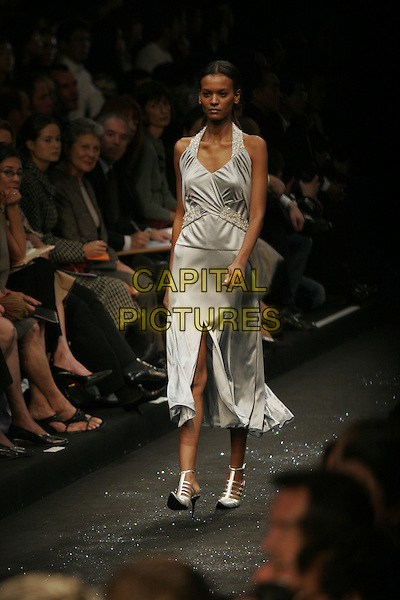MODEL.Largerfeld Spring/Summer 2005 ready-to-wear collection, Paris, France, October 6th 2004..full length catwalk Karl fashion show grey silver halterneck dress.Ref: MDS.www.capitalpictures.com.sales@capitalpictures.com.©O.Medias/Capital Pictures .