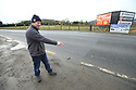 TO GO WITH BREXIT STORY BY WWILLIAM WALLIS DATE: 31 Jan 2019 - Padar MacNamee points to the border crossing on the Dublin Road outside Newry, South Armagh, Northern Ireland. Photo/Paul McErlane