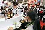 Visitors drink Japanese traditional hard liquor Shochu at the 42nd International Food and Beverage Exhibition (FOODEX JAPAN 2017) in Makuhari Messe International Convention Complex on March 8, 2017, Chiba, Japan. About 3,282 companies from 77 nations are participating in the Asia's largest food and beverage trade show. This year organizers expect 77,000 visitors for the four-day event, which runs until March 10. (Photo by Rodrigo Reyes Marin/AFLO)