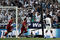 Liverpool's Mohamed Salah, center, celebrates past his teammate Jordan Henderson, left, after scoring on a penalty kick, as Tottenham Hotspur's Danny Rose reacts, during the UEFA Champions League final football match between Tottenham Hotspur and Liverpool at Madrid's Wanda Metropolitano Stadium, Spain, June 1, 2019.<br /> UPDATE IMAGES PRESS/Isabella Bonotto
