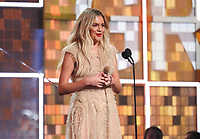 Kelsea Ballerini introduces a performance by Brandi Carlile at the 61st annual Grammy Awards on Sunday, Feb. 10, 2019, in Los Angeles. (Photo by Matt Sayles/Invision/AP)